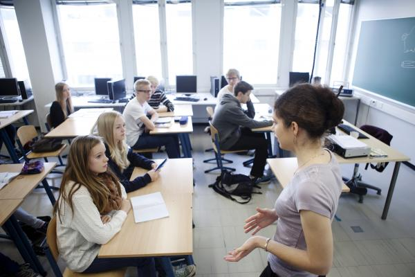 A teacher speaking to a class