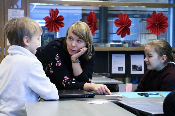 A teacher helping her pupils