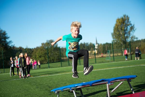 A boy bouncing on a trampoline