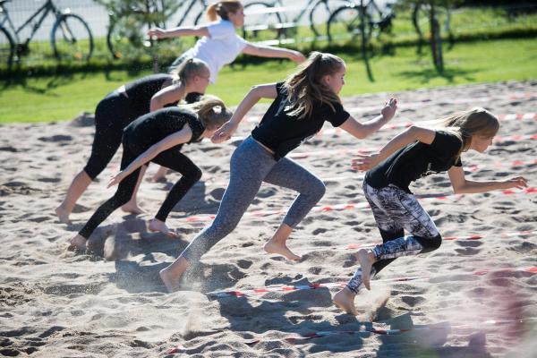 Children running in sand