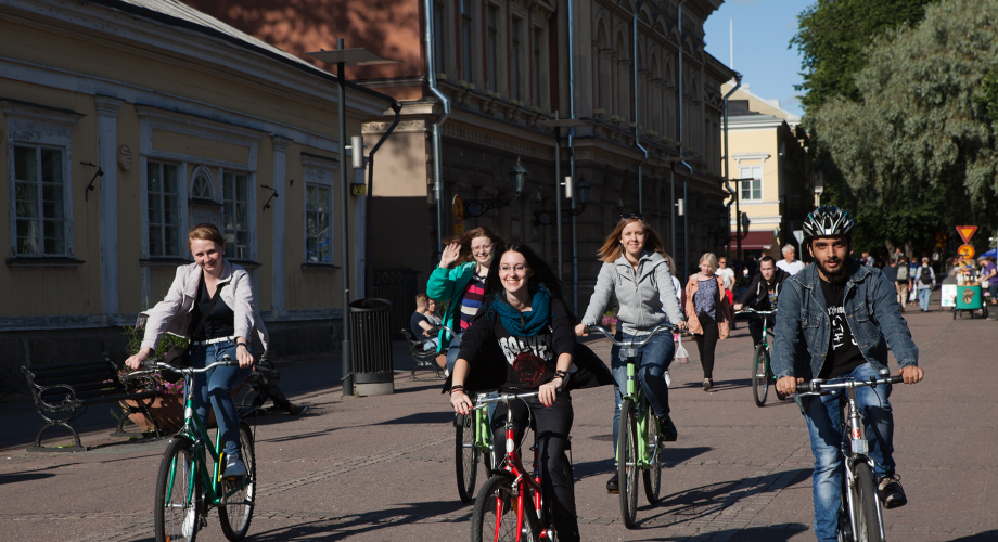 Foreign higher education students bicycling in Turku